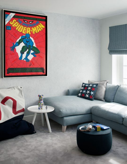A Spiderman film poster looks over a designed sitting room