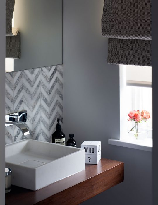 A beautiful sink in a compact space in a designed interior