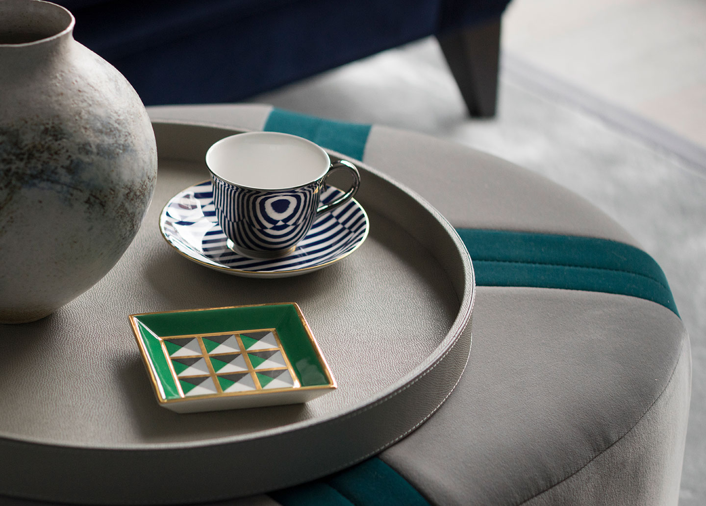 A detail of a cup on a coffee table in a designed interior