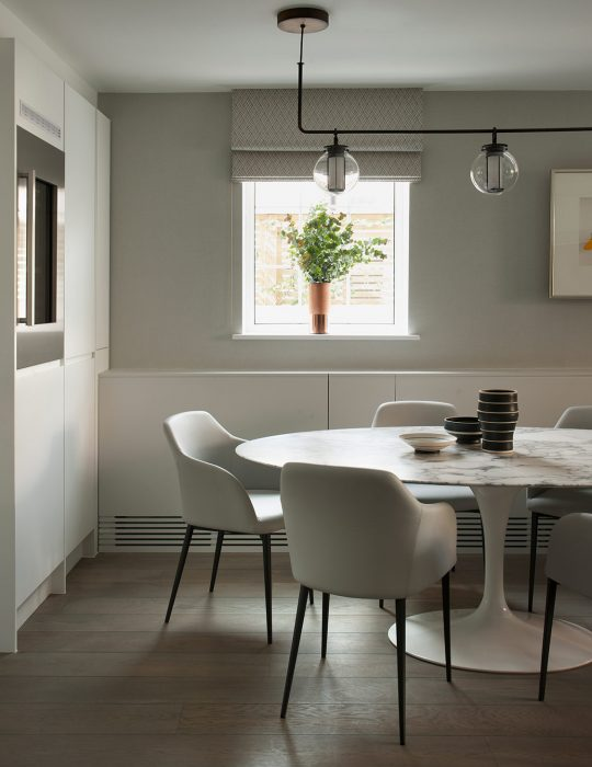 St Johns based Interior Design by Studio Suss in London. A round table sits in a minimally designed space.