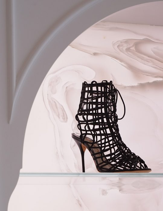 Sophia Webster feature shoe sits on display in the designed interior of the flagship store in Mayfair