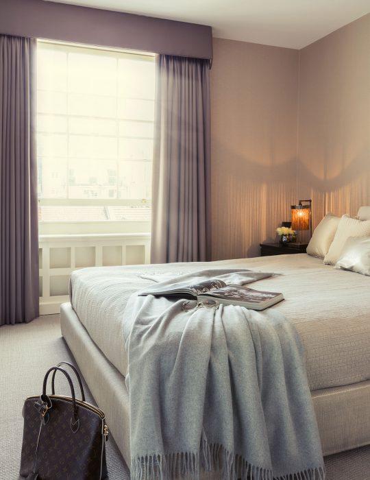 Sash window lights a stylishly designed bedroom