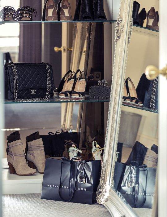 Luxury shoes and handbags in a luxury interior design bedroom