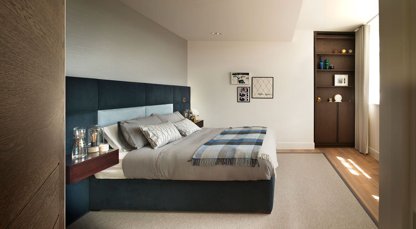 A king size bed in a spacious Soho bedroom