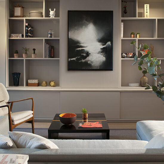 Residential interior design with corner sofa and geometric shelving
