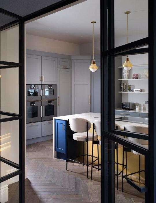 Glass frame door looking into kitchen - Luxury sustainable interior design