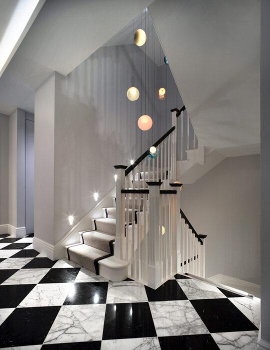 Hanging light art over tiled floor - Luxury sustainable interior design