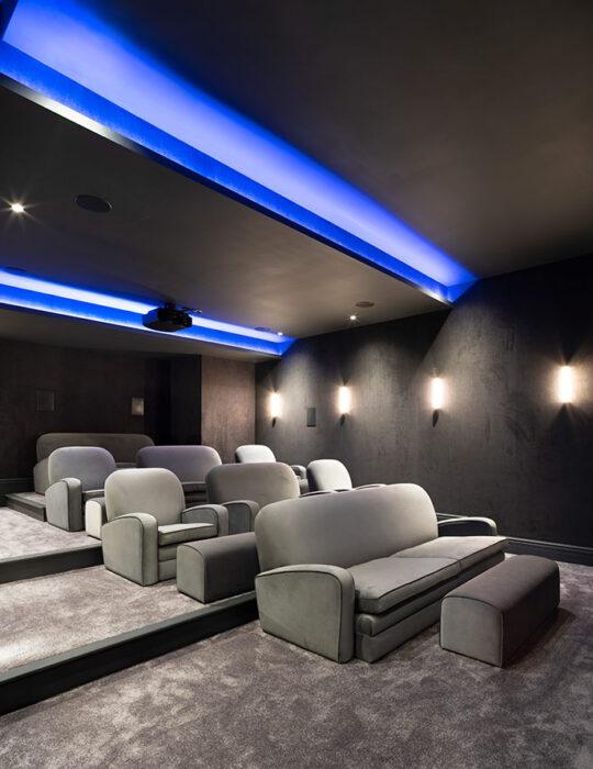 Blue lights, large home cinema - Luxury sustainable interior design