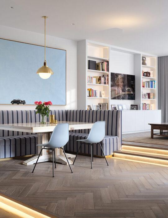Corner sofa under art and stylish light - Luxury sustainable interior design