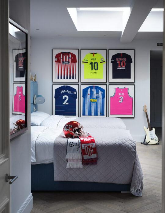 Framed football shirts on wall - Luxury sustainable interior design