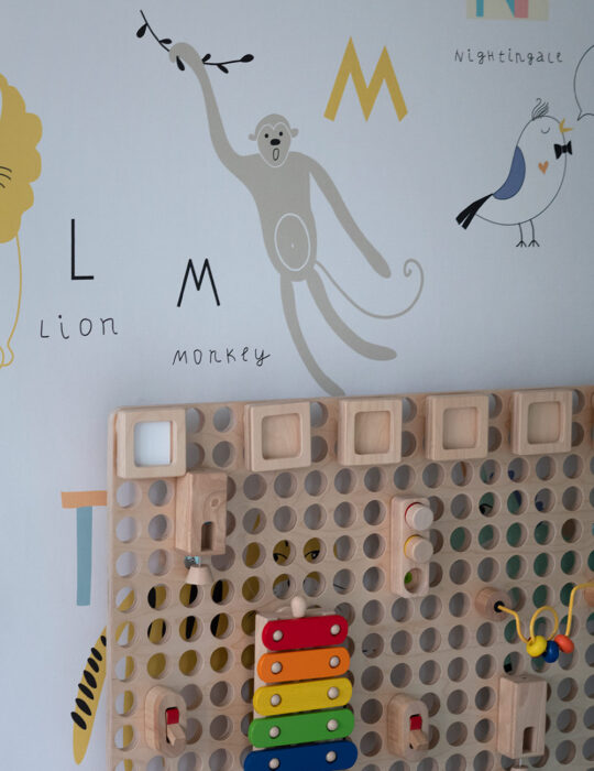 Wallpaper and wooden gaming wall - Luxury sustainable nursery interior design